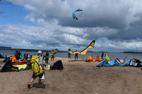 Kiteboarders getting ready on the beach near Wahkon MN