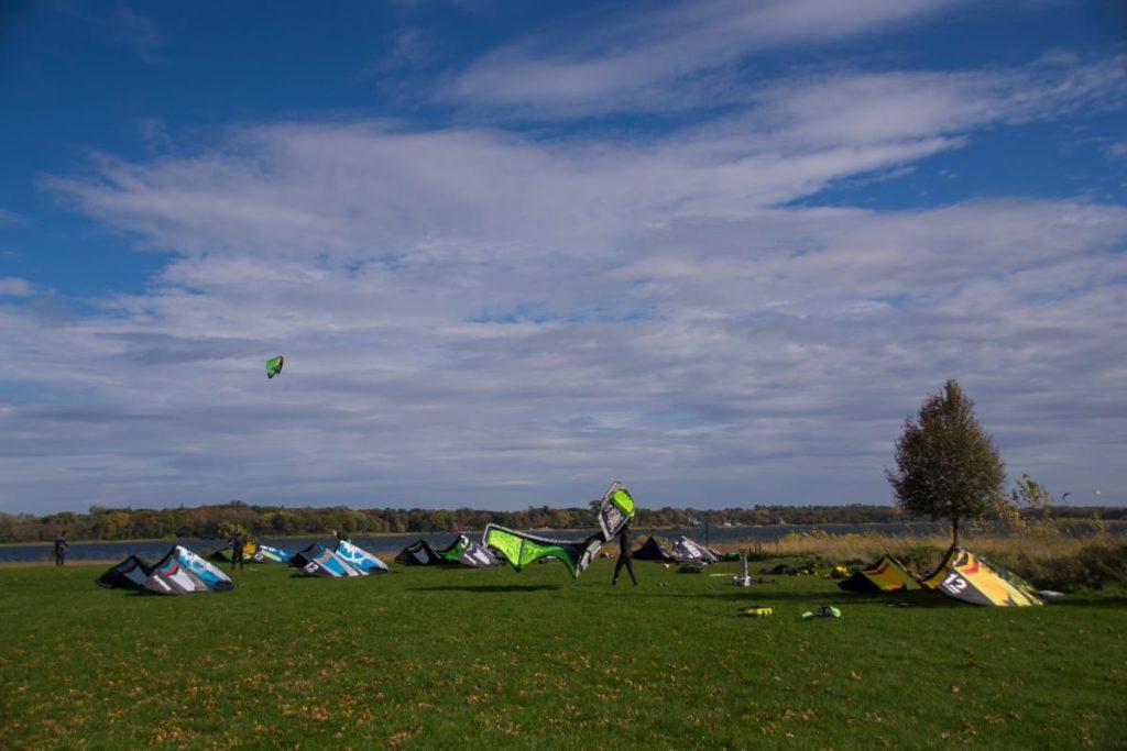 Kites sitting on the green grass at White Bear Lake