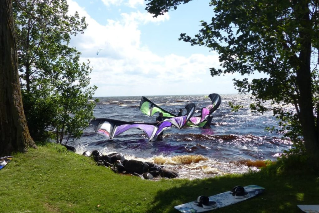 Kiteboarders carry their kites out into Lake Mille Lacs