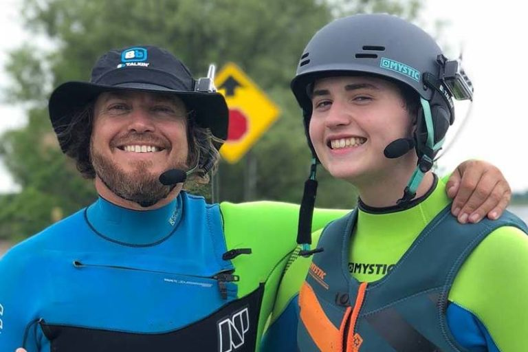Stoked Kiteboarding instructor Scott with a smiling student