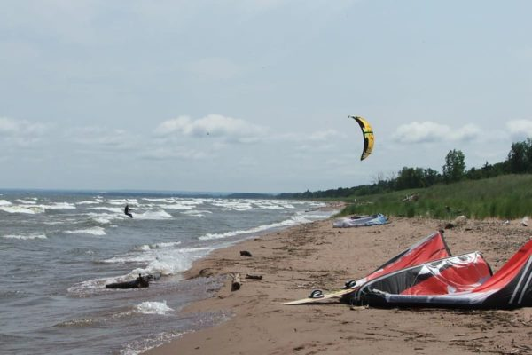 Kiteboarders enjoying the day in Duluth at Park Point