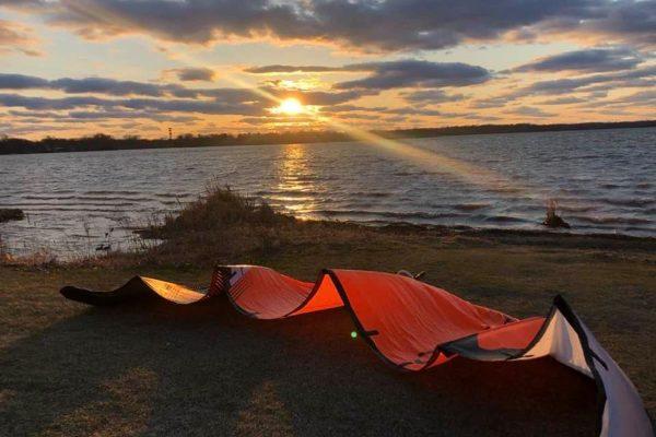 Kiteboarding kite laying on the grass at Medicine Lake